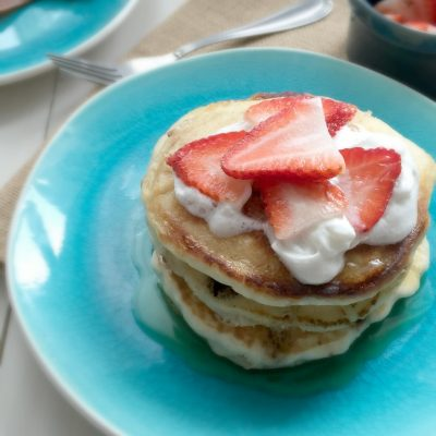 chocolate chips pancakes with fresh strawberries and whipped cream